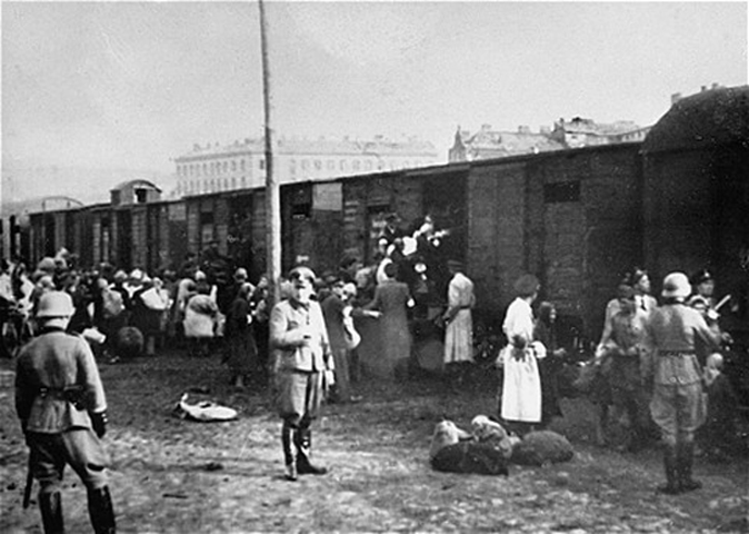 Jews loading onto trains at the Umschlagplatz in Warsaw during the German occupation of Poland. Umschlagplatz is German for collection or reloading point. This photo is of the square in Warsaw where, under German occupation, Jews gathered for deportation from the Warsaw Ghetto to Treblinka.