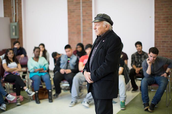 Holocaust survivor Nate Leipciger giving his testimony to students.   Photo credit Nick Kozak