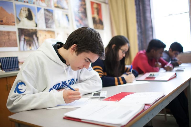 Students in a Facing History classroom use journals to record reflections and questions.  Photo credit: Nick Kozak