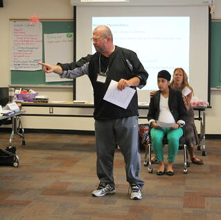 Educators at a Facing History seminar try Reader's Theatre for themselves.