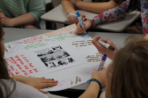 students responding to Maus on big paper