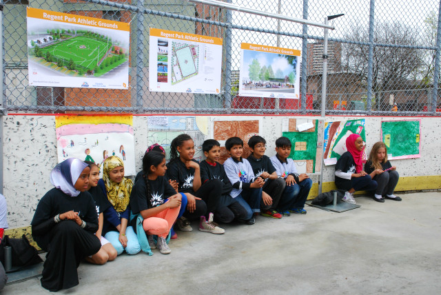 """4th grade students at Nelson Mandela Park Public School present their drawings of the new Regent Park.  Photo originally posted on May 15, 2014 Toronto Star blog """"Phase 3 of Regent Park Revitalization in the Works!"""""""