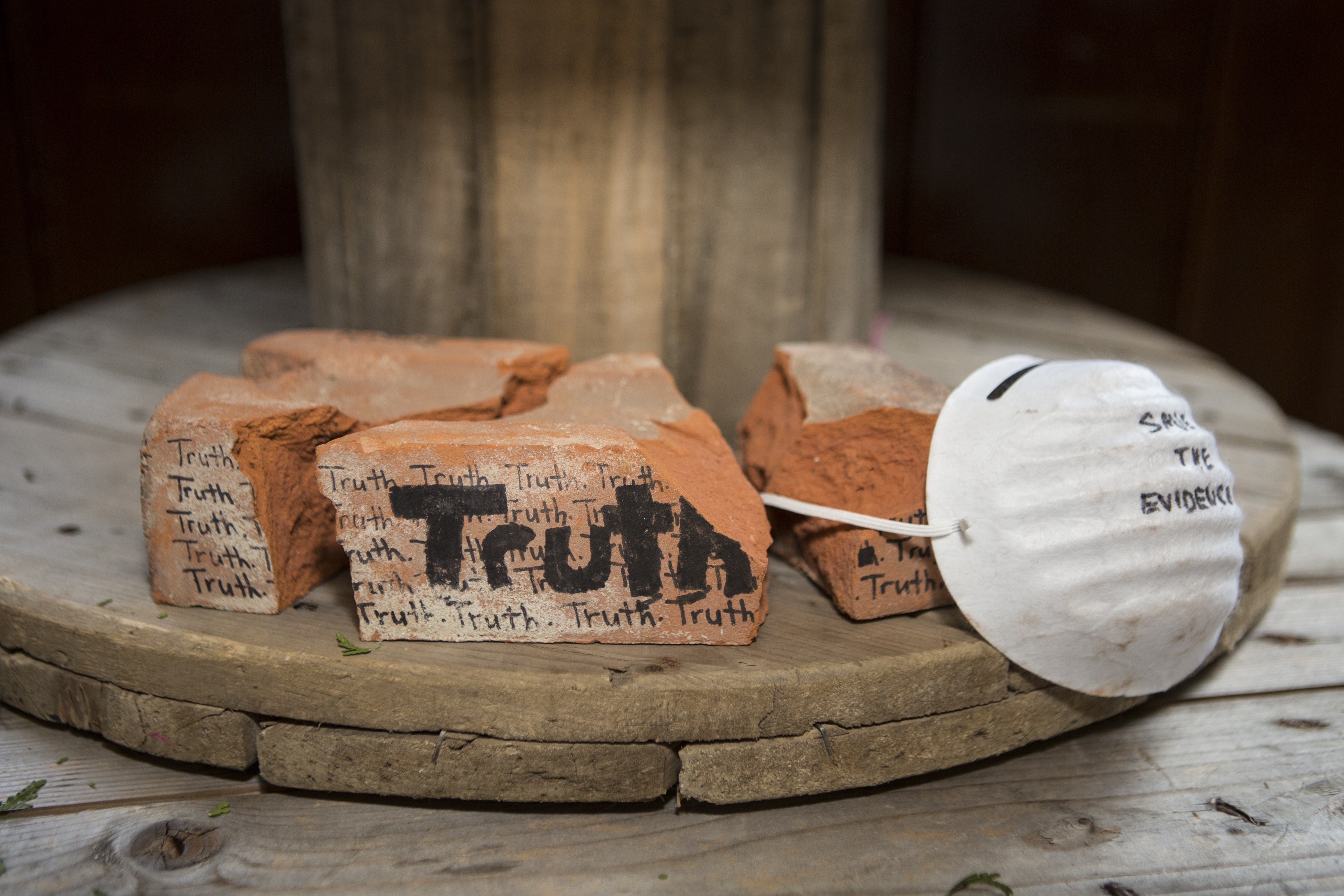 Students create a model memorial using broken bricks with the words Truth written on them for residential school survivors and those who did not survive in response to a visit to the former Mohawk Institute residential school and contemporary testimony of intergenerational survivor Kim Wheatley. Photo courtesy Nick Kozak for Facing History and Ourselves.